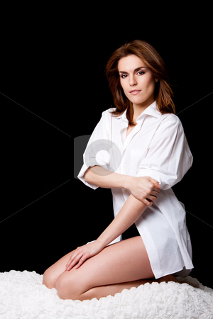 Sexy beautiful female stock photo, Sexy beautiful brunette wearing a white shirt, natural and pure, sitting on knees on a white cloud, isolated by Paul Hakimata