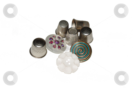 Thimbles and Buttons stock photo, Vintage metal thimbles and buttons on a white background by Sandra Fann