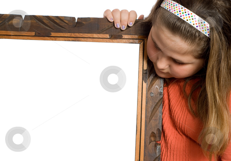 Girl Holding Copyspace stock photo, Closeup view of a young girl holding a blank sign and looking at it by Richard Nelson