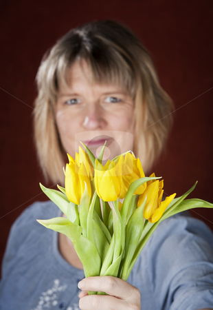 Woman with Yellow Tulips stock photo, Pretty woman with a bunch of yellow tulips by Scott Griessel