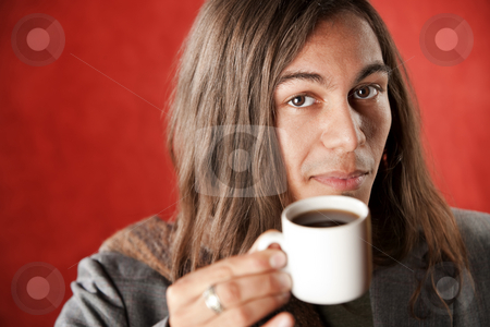 Handsome Young Man Drinking Coffee stock photo, Closeup Portrait of a Handsome Young Man with Long Hair Drinking Coffee by Scott Griessel
