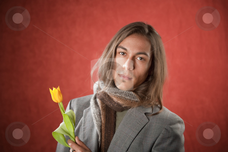 Handsome Young Man with Yellow Tulip stock photo, Closeup Portrait of a Handsome Young Man with Yellow Tulip by Scott Griessel