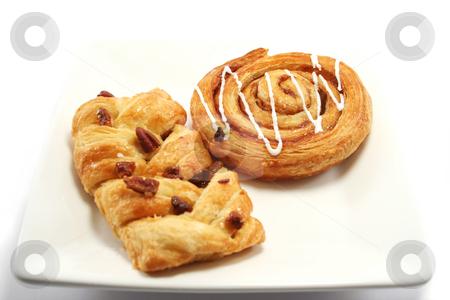 Danish Pastry Variety stock photo, Cinnamon Swirl and maple/pecan slice, danish pastries on a plate by Helen Shorey