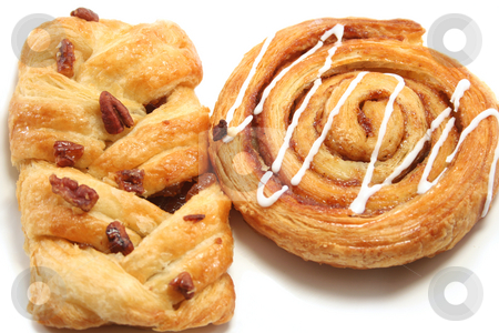 Danish Pastry close up stock photo, Cinnamon swirl and a maple/pecan danish pastry close up by Helen Shorey