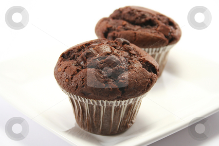 Choc Chip Muffin Close Up stock photo, Focus is on front muffin - double choc chip by Helen Shorey