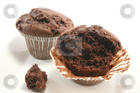 Half Eaten Choc Chip Muffin stock photo, Double choc chip muffins with one half eaten by Helen Shorey