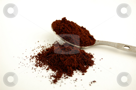 Spoon coffee stock photo, A Spoon with dust coffee over a white background by ALESSANDRO TERMIGNONE