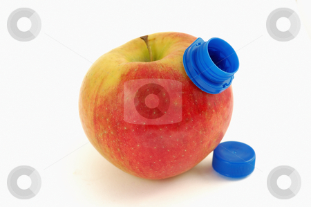 Drinking apple stock photo, Drinking apple juice concept : red apple with plastic cork over white background. by ALESSANDRO TERMIGNONE