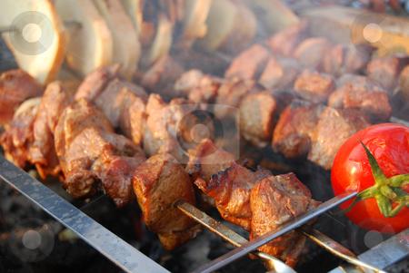 Shashlik stock photo, Fried pork with tomato and bread by Leyla Akhundova