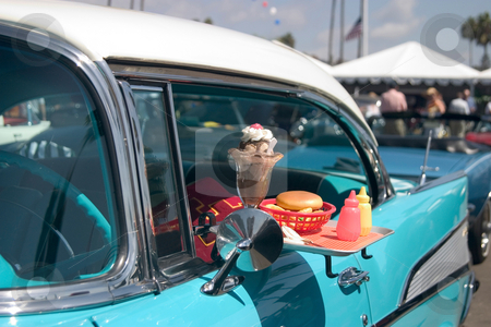 Classic Fast Food stock photo, Classic car with food tray attached to the driver's window. by Rick Parsons
