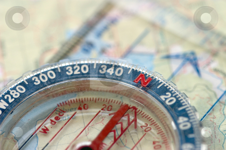 Compass and Map, Macro stock photo, Macro view of a compass sitting on a topo map, sharp focus on the 'N'. by Rick Parsons