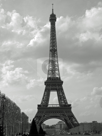 Eiffel Tower stock photo, Black and white image of Eiffel Tower with sky background by Jaime Pharr