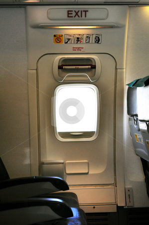 Emergency exit door. stock photo, Emergency exit row. Passenger cabin of a commercial airliner by Fernando Barozza