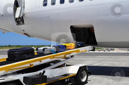 Airplane loading / offloading luggage stock photo, Jet airliner on the ramp loading / offloading luggage by Fernando Barozza