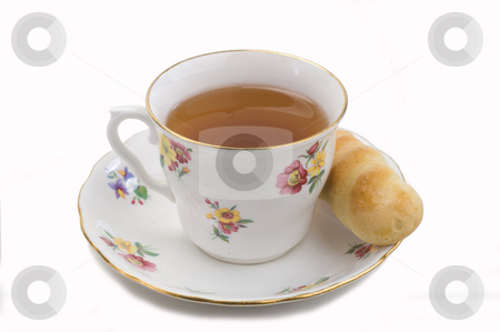 Tea and cookie stock photo, China cup and saucer with tea and a cookie by Jonathan Hull