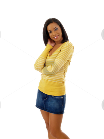 Young black woman in yellow sweater and jean skirt stock photo, Young woman standing in yellow top and jean skirt by Jeff Cleveland