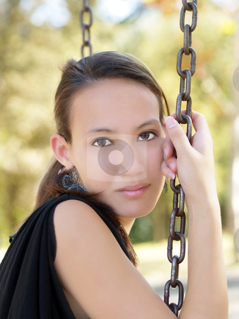 Young asian american woman sitting on swing stock photo, Outdoor portrait of young asian american woman on swing by Jeff Cleveland