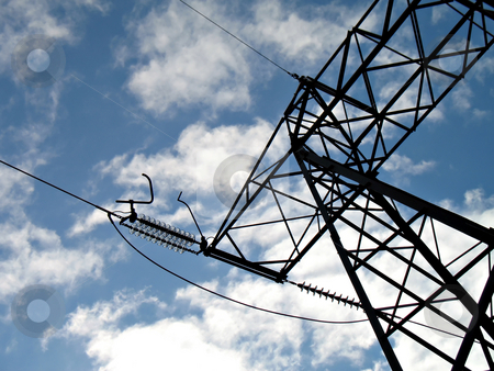 Electric high voltage line stock photo, A silhouette of an hydroelectric high-voltage electrical line in mountain by Roberto Marinello