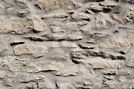 stone wall stock photo, Stone wall with cement of a rural house by Roberto Marinello