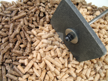 Wood pellets and shovel stock photo, Wood pellets for fireplaces and stoves and small shovel by Roberto Marinello