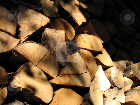 Firewood stock photo, A woodpile of chestnut and beech for stoves by Roberto Marinello