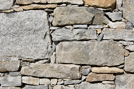 Rural stone wall stock photo, A wall of a rural mountain house made of stones by Roberto Marinello