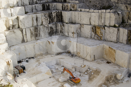 Quarry of white marble stock photo, An open quarry of white marble with bulldozer, in Carrara, Tuscany, Italy by Roberto Marinello