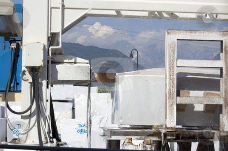 Marble cutting machine stock photo, A cutting machine working a block of white marble, Tuscany, Italy by Roberto Marinello