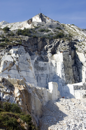 Quarry of white marble stock photo, An open quarry of white marble in Carrara, Tuscany, Italy by Roberto Marinello