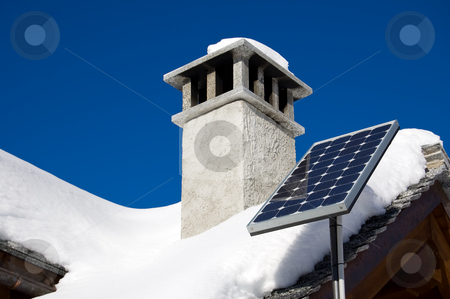 Mountain solar panel stock photo, A small solar panel installed on a mountain house roof by Roberto Marinello
