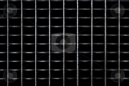 Worn Metal Grate stock photo, A metal subway grate texture that is worn and weathered. by Todd Arena