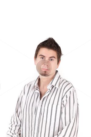 Portrait of young man in striped shirt, studio shot stock photo, Portrait of young man in striped shirt, studio shot by Tom P.