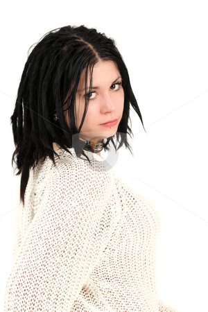 Teenage girl with face piercings stock photo, Portrait of young teenage girl with face piercings wearing sweater, studio shot by Tom P.