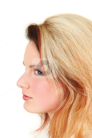 Side view of young woman, studio shot stock photo,  by Tom Prokop