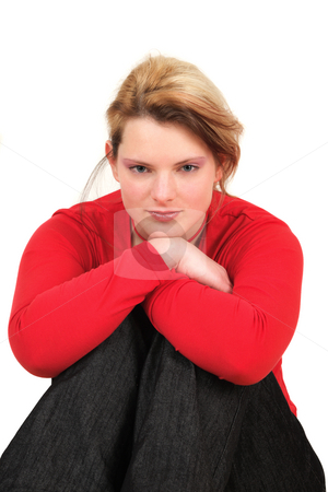 Portrait of young woman in red shirt, studio shot stock photo, Portrait of young woman in red shirt, studio shot by Tom Prokop