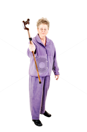Senior woman with cane. stock photo, Senior woman with gray hair and an lilac suit needs the help of a cane to get around. On white background. by Horst Petzold