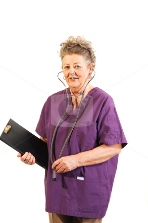 Senior nurse. stock photo, An elderly nurse in a lilac top with the stethoscope in her ears and the clip board in her hand. On white background. by Horst Petzold