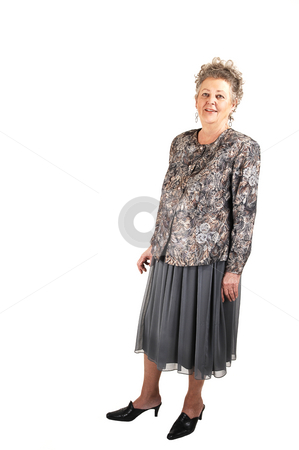 Senior woman standing. stock photo, An lovely senior woman, all dressed up, standing for white background and enjoying her life. by Horst Petzold