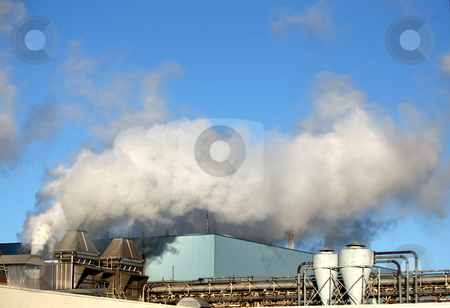 Billowing Smoke at Industrial Factory stock photo, Under a blue sky, smokestacks billowing smoke and air pollution at a manufacturing factory by Tom and Beth Pulsipher