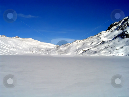 Winter frozen lake  stock photo, A frozen lake (Toggia) covered of snow in Val Formazza, Ossola, Itlay by Roberto Marinello