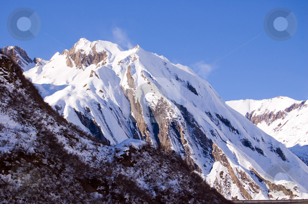 Windy snowy peak stock photo, A mountain peak full of snow and ruffled by wind, Formazza Valle Ossola, Italy by Roberto Marinello