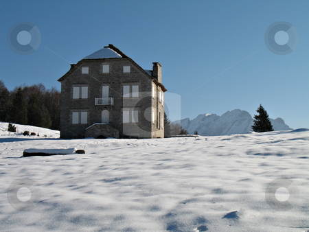 House of stones in mountain stock photo, House of stones in the snow in mountain in a wonderful sunny day by Roberto Marinello