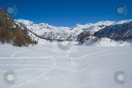 Icy winter alpine lake stock photo, Icy alpine lake landscape full of snow; Alps, Italy by Roberto Marinello