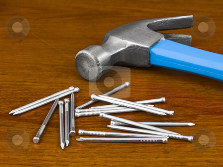 Hammer and Nails stock photo, Hammer and Nails on a wooden background by John Teeter