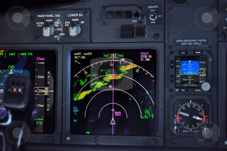 Flight deck, airplane instrument panel stock photo, Commercial airliner approaches line of thunderstorms at 33000 feet by Fernando Barozza