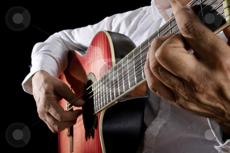 Guitarist stock photo, Close up of man playing classical guitar by iodrakon