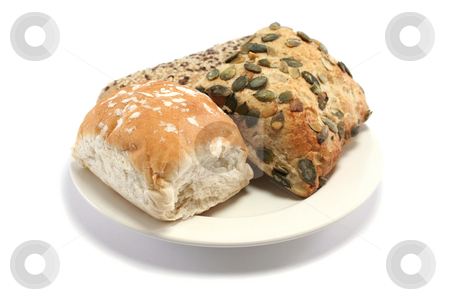 Bread Roll Selection stock photo, Sesame seeded, pumpkin seed and plain white bread rolls on a plate by Helen Shorey
