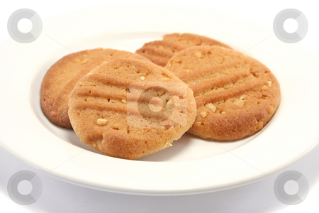 Homemade Cookies on a Plate stock photo, Four golden peanut butter homemade cookies on a china plate by Helen Shorey