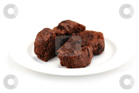 Two Chocolate brownie Slices stock photo, Two slices of a chocolate brownie cake on a white plate against a white background by Helen Shorey