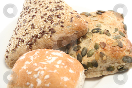 Close up of Bread Rolls stock photo, Sesame seed, pumpkin seed and plain white rolls on a plate - closeup by Helen Shorey
